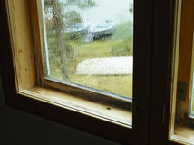 RAin and moisture condensation. At the window, old structure Royalty Free Stock Images