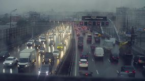 Rain in Moscow. View to traffic on the bridge. Time lapse. Rain in Moscow. High angle view to traffic on the bridge stock video footage