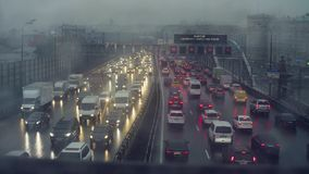 Rain in Moscow. View to traffic on the bridge. Time lapse. Rain in Moscow. High angle view to traffic on the bridge stock video