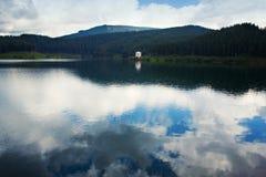 Rain on mountain lake Royalty Free Stock Photography