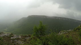 Rain in the mountains. Crimea. Ukraine. Plateau Baba-Dag. Cave city Mangup-Kale. . stock video