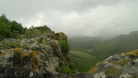 Rain in the mountains. Crimea. Ukraine. Plateau Baba-Dag. Cave city Mangup-Kale. stock footage