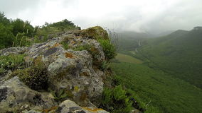 Rain in the mountains. Crimea. Ukraine. Plateau Baba-Dag. Cave city Mangup-Kale. stock video footage