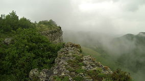Rain in the mountains. Crimea. Ukraine. Plateau Baba-Dag. Cave city Mangup-Kale. XIV-XVIII centuries stock video