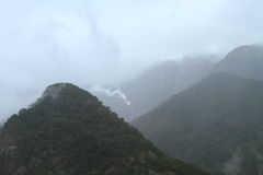 Rain in the mountains. Rain and overcast in the mountains. Westland Tai Poutini National Park, New Zealand Stock Image