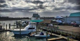 Rain Moving Over the Marina. A wave of raining approaching a marina near Wilmington, NC Royalty Free Stock Photo