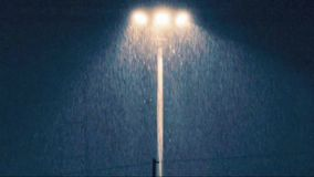 Rain at night with light lamp stock video