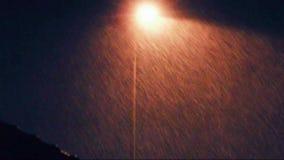 Rain at night with light lamp stock footage