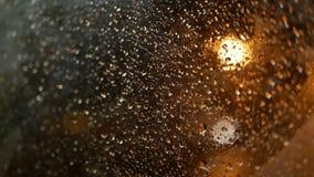 Rain night window city. Rain water drops on bus window glass stock video