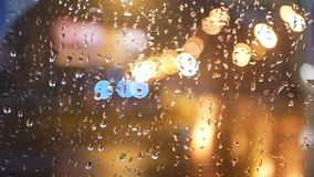 Rain night window city. Rain water drops on bus window glass stock video footage