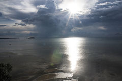 After the rain, November 2014. The sun after the rain make a gold reflection on the ocean Royalty Free Stock Photography