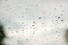 Rain On Window With Blurred Background Stock Photography