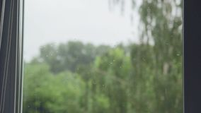 The rain outside the window stock video footage