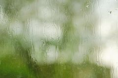 The rain outside the window. rain drops on glass spring or autumn royalty free stock photography