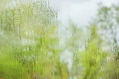 The rain outside the window. rain drops on glass spring or autumn stock photos