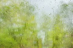 The rain outside the window. rain drops on glass spring or autumn stock image
