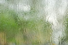 The rain outside the window. rain drops on glass spring or autumn royalty free stock images