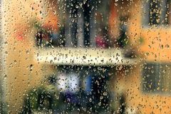 In the rain outside the window. Natural weather, rainy day, rain on the window, hazy scenery outside the window Royalty Free Stock Photos