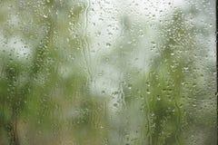 The rain outside the window. rain drops on glass spring or autumn royalty free stock photos