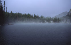 Rain over alpine lake in Rocky Mountains Royalty Free Stock Photos