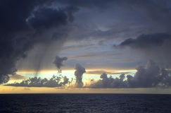 Rain over the Atlantic ocean. Tropical rain a short , as the mood of a woman Royalty Free Stock Photos