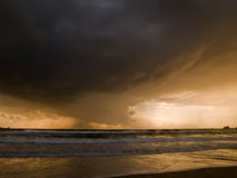 Rain over the Horizon. Dusk rainshowers over the horizon at Golden Bay in Malta Royalty Free Stock Images