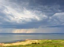 Rain over lake Stock Photos