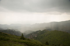 Rain over mountains Stock Photo