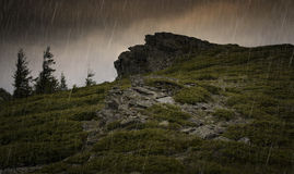 Rain over rocks at mountain Stock Image
