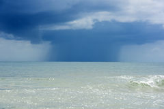 Rain over the sea clouds Stock Photography