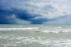 Rain over the sea clouds Stock Image