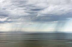 Rain over the sea Stock Photo
