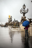 Rain in Paris. The man staing on the bridge in Paris Stock Image