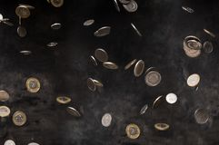 Rain of polish coins. On dark background Royalty Free Stock Images