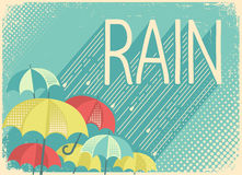 Rain poster background with stylish text and umbrellas Stock Images
