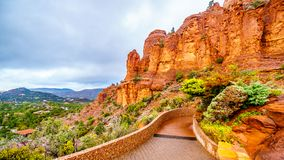 Rain pouring down on the geological formations of the red sandstone buttes surrounding the Chapel of the Holy Cross at Sedona stock image