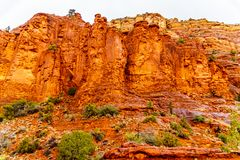 Rain pouring down on the geological formations of the red sandstone buttes surrounding the Chapel of the Holy Cross at Sedona stock images