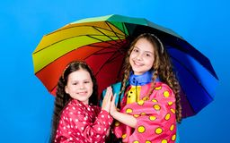 Rain protection. Rainbow. autumn fashion. happy little girls with colorful umbrella. cheerful hipster children royalty free stock photography