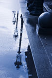 Rain puddles. Street lamps reflected in the rain puddles Stock Images
