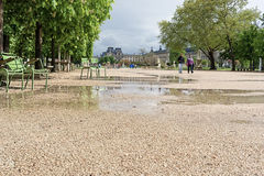 Rain puddles in park. Paris, France royalty free stock photos