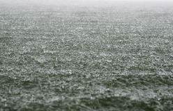 Rain on the river. Strong rain on the river in autumn royalty free stock photography