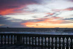 After rain. It roared the sea as the sun went down steeply behind the rain clouds just ended Stock Image
