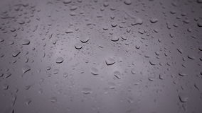 Rain running down or shower on window background, closeup shot High quality footage in 4K stock video footage