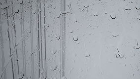 Rain running down or shower on window background, closeup shot High quality footage in 4K stock video