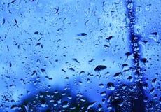 Rain running down window Stock Photography