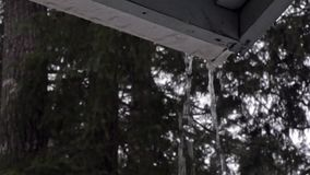Rain running off of old gutter at bottom of home stock video