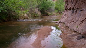 Rain in sandstone canyon with a stream stock footage