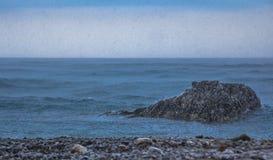 Rain on the sea Stock Image