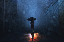 Rain and shine. A woman in a rain storm has a sunny reflection royalty free stock photos