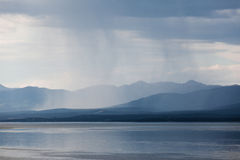 Rain shower over Marsh Lake Yukon Territory Canda Stock Image